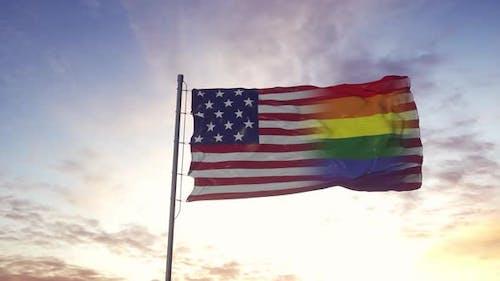 Waving national flag of USA and LGBT rainbow flag background