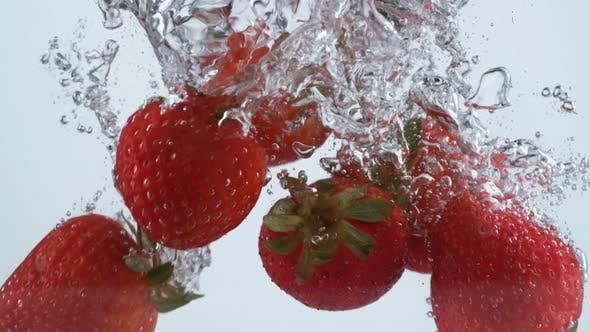 Thumbnail for Slow motion shot of strawberries splashing into water, shot with Phantom Flex 4K camera.