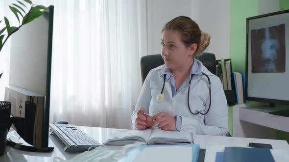 Thumbnail for Consultation Online, Female Doctor Communicates with Sick Patient Via Video Communication and Writes