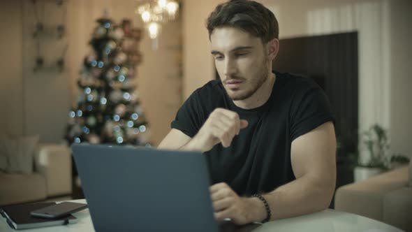 Thumbnail for Male Person Using Laptop in Home at Christmas Holiday. Man Working on Computer