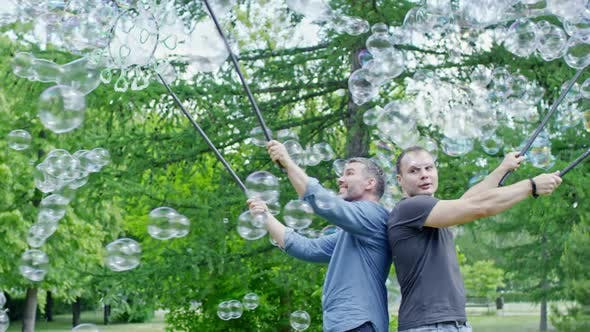 Cover Image for Men Performing Soap Bubbles Tricks in Park