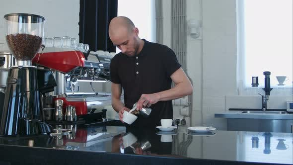 Thumbnail for Barista Pouring Coffee Into White Cup