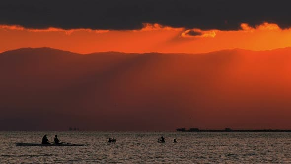 Thumbnail for Canoe And Mussel Fishing People Silhouette In Sea And Sunset