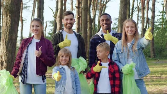 Thumbnail for Activists from Community of Nature Lovers Posing on Camera with Plastic Bags
