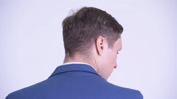 Cover Image for Rear View Head Shot of Young Handsome Businessman Looking Back