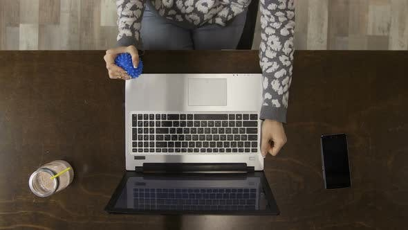 Top View Hands on Laptop with Antistress Ball