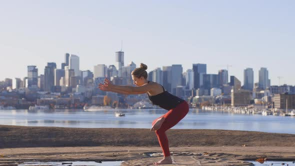 Thumbnail for Flexible Woman Doing Yoga Tree Crow Pose Focused Mindful Stretching