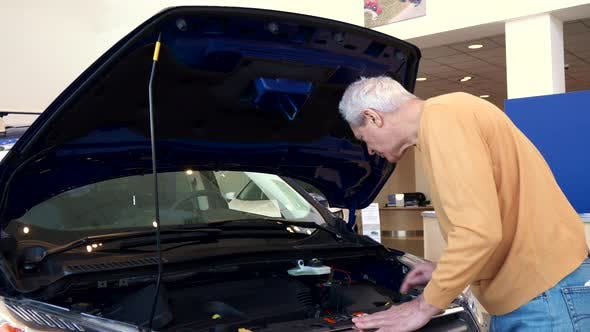Thumbnail for Senior Man Looks at Engine Compartment