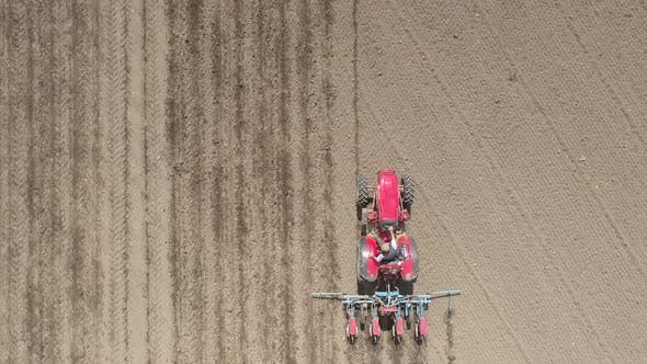 Thumbnail for Aerial View Large Tractor Cultivating a Dry Field. Top Down Aerial View Tractor Cultivating Ground