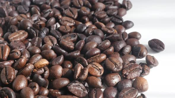 Thumbnail for Roasted Arabica coffee beans  4K slow pan footage