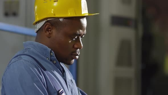 Thumbnail for Afro-American factory engineer with laptop