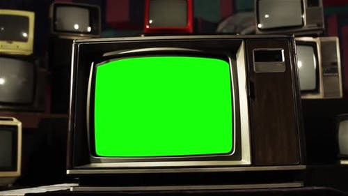 Old TV Green Screen in the Middle of Many TVs. Aesthetics of the 80s.