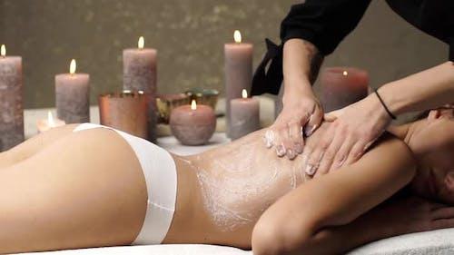 Close-up of Masseur Arm Doing Massage for Female Back
