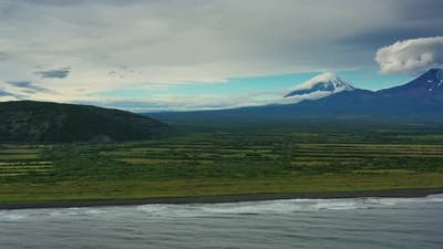 Beach with Black Sand and Volcano