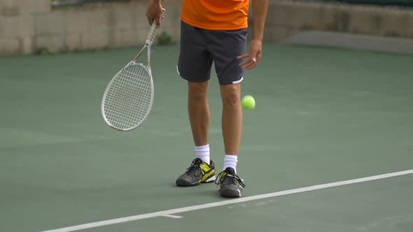 Thumbnail for Male tennis player serving during match.