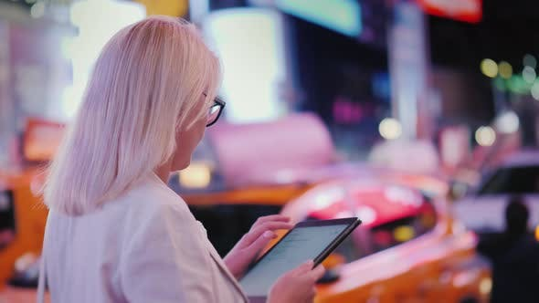 Thumbnail for Business Woman Uses Tablet on Busy Times Square in New York