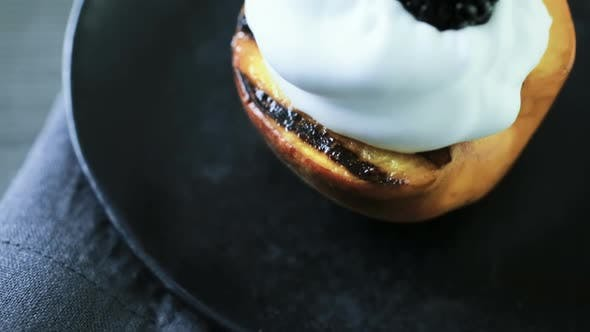Thumbnail for Grilled organic peaches with whipped cream, and garnished with fresh mint.