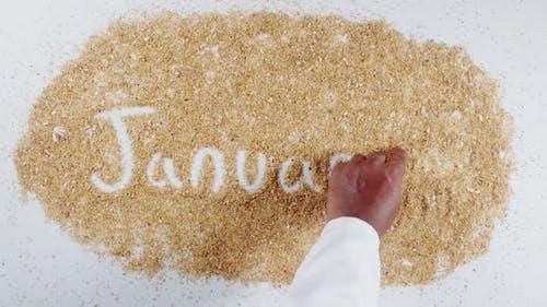 Hand Writes On Sand   January