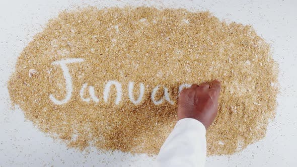 Thumbnail for Hand schreibt auf Sand Januar