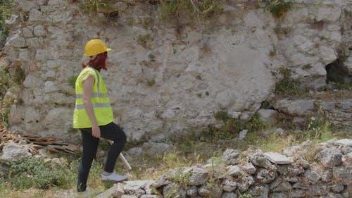 Female architect walks up a hill