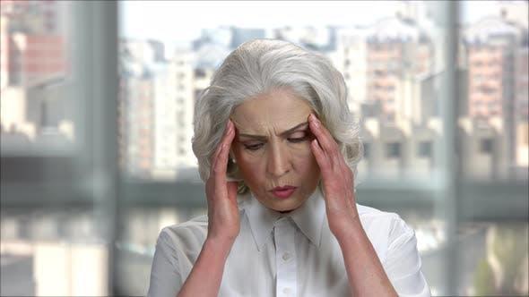 Old Businesswoman's Suffering From Headache