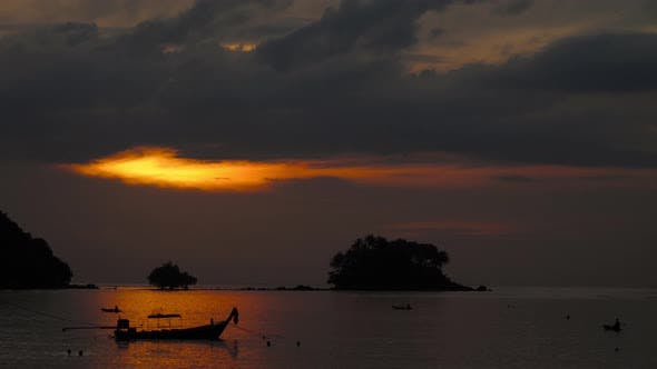 Thumbnail for Longtail Boat in the Tropical Sea at Dramatic Sunset