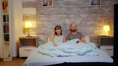 Zoom in Shot Couple in Pajamas Laughing