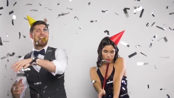 Thumbnail for Happy Couple with Party Blowers Having Fun