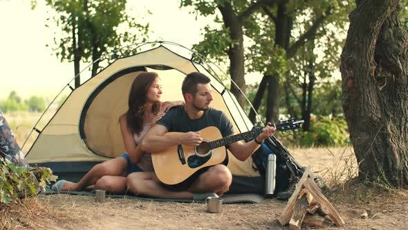 Thumbnail for Young Couple Playing on Guitar in the Forest