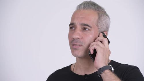 Happy Handsome Persian Man Talking on the Phone