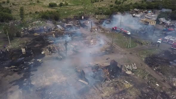 Thumbnail for Working Firefighters on Smouldering Ruins in Village, Aerial View
