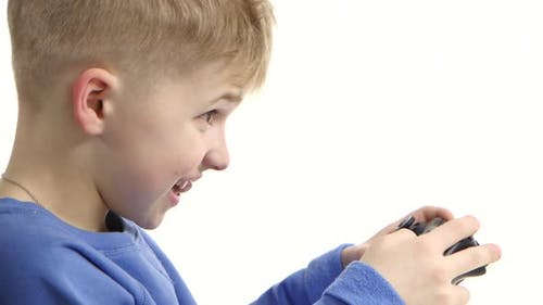 Boy Playing Video Game with Games Console. White Background, Closeup