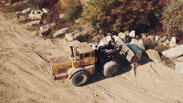 Specially Equipped Machine With a Bucket id Working Near a Quarry With Stones