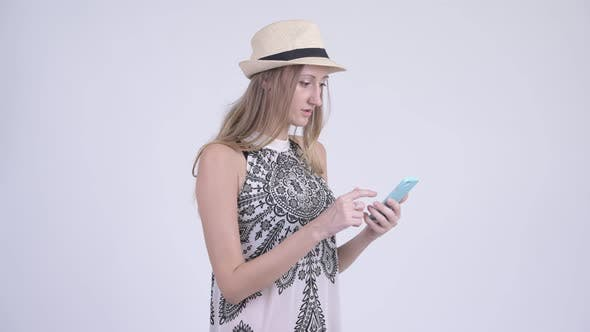 Thumbnail for Portrait of Happy Blonde Tourist Woman Using Phone and Looking Surprised