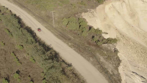 Thumbnail for Old Red Jeep On Dusty Track Aerial Following 7