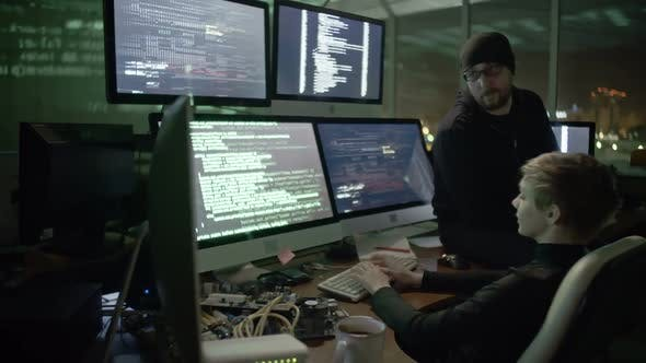 Thumbnail for Female Hacker Gaining Secure Information with Colleague Assistance