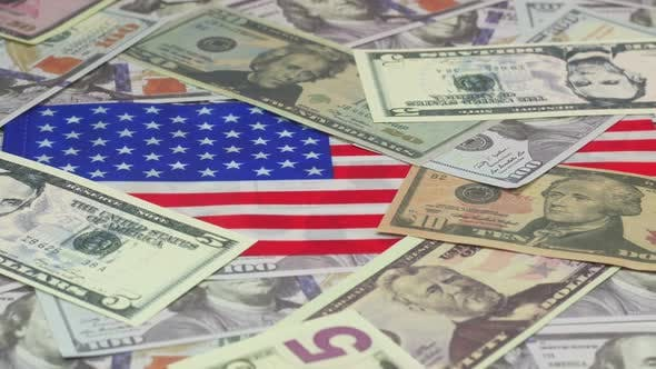 Us Dollar Banknotes And American Flag
