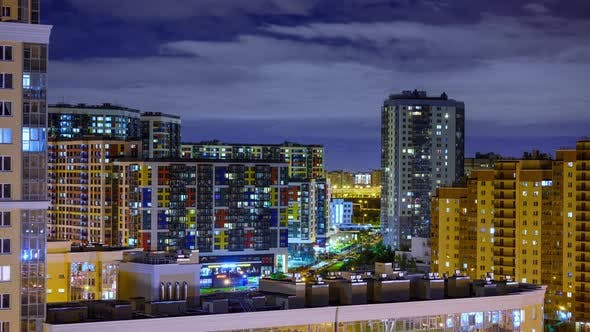 timelapse of the night city. buildings in the light of lanterns, traffic.