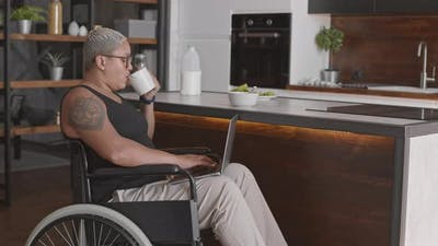 Handicapped Woman Using Computer