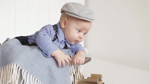 Thumbnail for Adorable Little Boy Wearing a Gray Cap