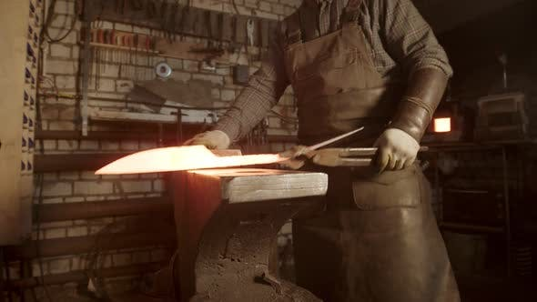 Thumbnail for A Man Blacksmith Making a Knife with Twisted Handle