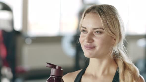 Fitness Woman Enjoying Fresh Water at Cardio Training in Gym