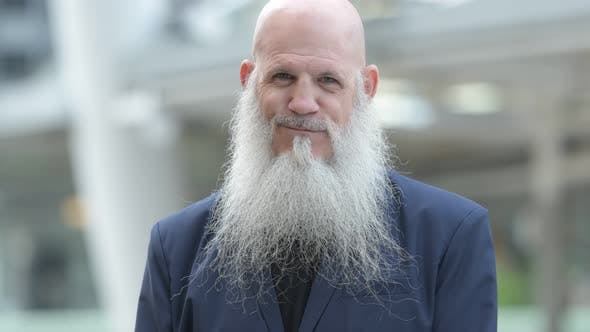 Thumbnail for Face of Happy Mature Bearded Bald Businessman Smiling in the City Outdoors