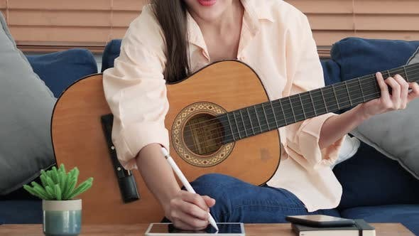 Thumbnail for Creative woman playing guitar