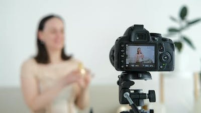 Young Woman Speaking in Front of Camera for Vlog