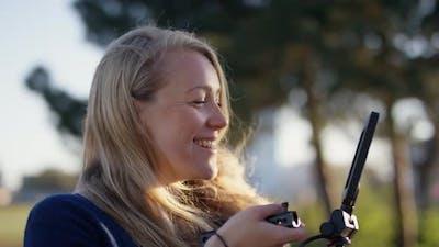 Female Film Maker Smiling As She Films