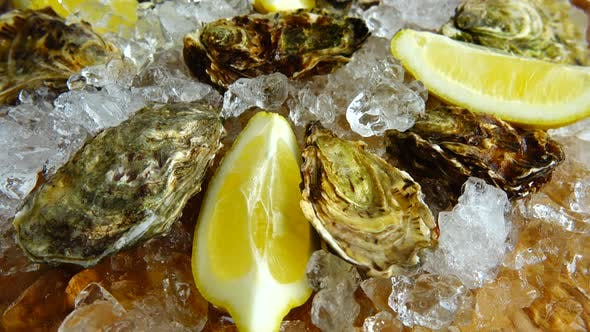 Oysters on ice on a rotating board.