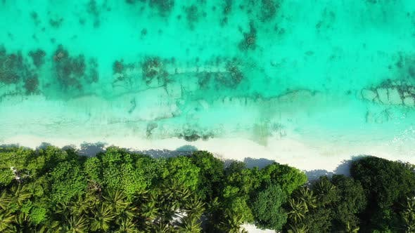 Thumbnail for Wide overhead copy space shot of a white sandy paradise beach and blue ocean background in vibrant 4