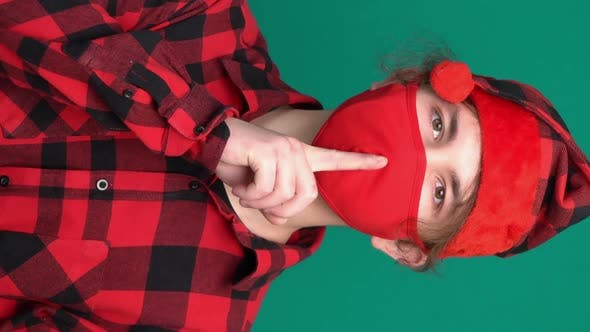 Thumbnail for Secret Teen Santa Hat Saying Hush Be Quiet with Finger on Lips Shhh Gesture in Medical Face Mask