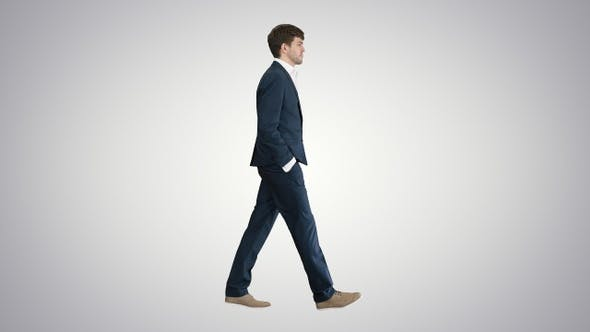 Thumbnail for Handsome business man walking with his hands in pockets